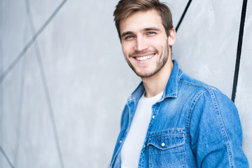 Perfect man. Portrait of happy fashionable handsome man in jeans shirt. Wall mural