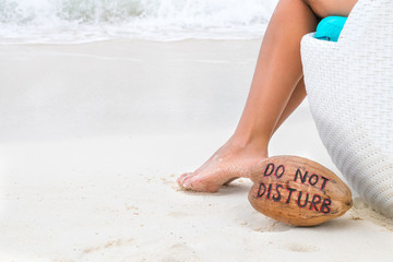Wall Mural - Woman feet on white sand and coconut with message