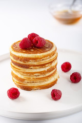 Fresh homemade pancakes with berries and syrup