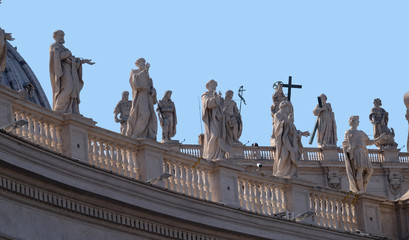 Gallery of saints, fragment of colonnade of St. Peters Basilica. Papal Basilica of St. Peter in Vatican - the world largest church, is the center of Christianity in Rome, Italy