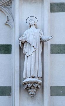 Statue of St. Margaret Mary Alacoque on the facade of Sacro Cuore del Suffragio church in Rome, Italy
