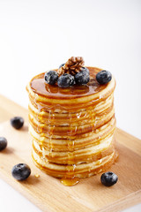 Fresh homemade pancakes with blueberries and syrup