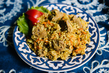 Pilaf with fresh vegetables on a plate