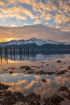 Alaskan sunrise reflection with snow covered mountains