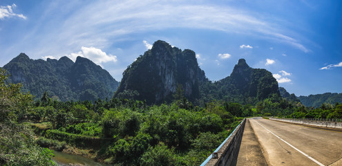 Beautiful landscape with Bridge over the river Sok, tropical forest and mountains, Khao Sok National Park, Surat Thani Province, Thailand.