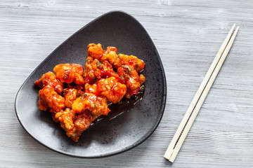 spicy fried Chicken with chopsticks close up