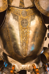 Vintage golden full plate armor with ornament