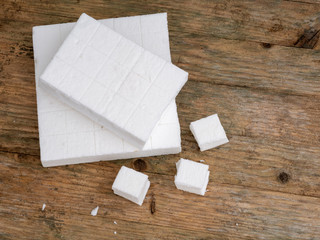 White firelighters for barbecue, open fire etc. Small, solid fuel tablets.