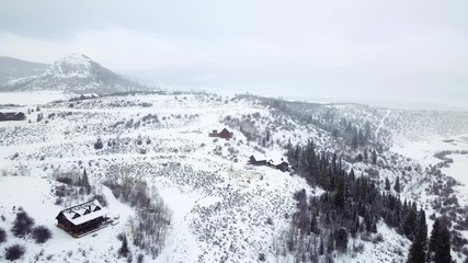 Wall Mural - Aerial view of rural mountain road in the Winter.