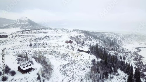 Wall mural Aerial view of rural mountain road in the Winter.