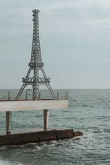 eiffel tower over the black sea.