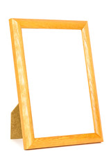 Standing wooden picture frame on white background