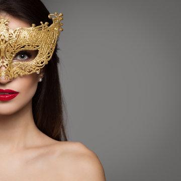Portrait of woman in carnival golden mask. Copyspace.