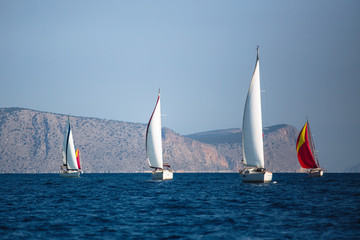 Wall Mural - Adventure and luxury holiday. Sailing boats in the sail yacht regatta at Aegean Sea.