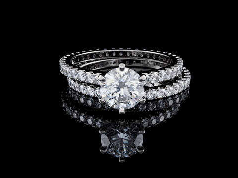 Solitaire diamond engagement ring, eternity wedding band on black background