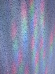 White stipple effect wall with rainbow lights texture background
