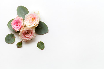 Spring white background with roses. Top view.