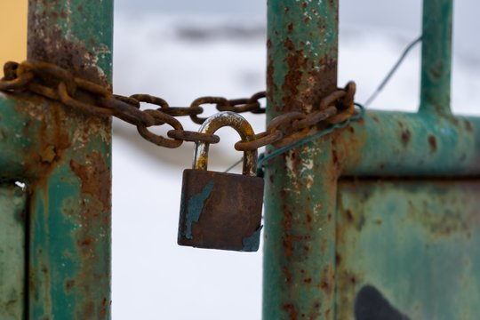 Padlock on the gate in the meadow fence. Slovakia