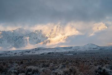 snow clouds in morning light deposited fresh snow on desert valley and Sierra Nevada mountain range
