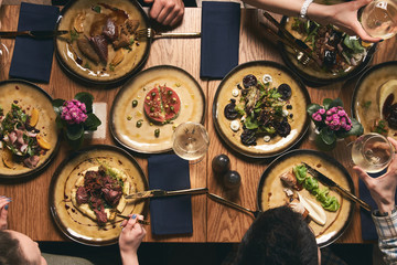 People eat healthy meals and drink alcohol festive table