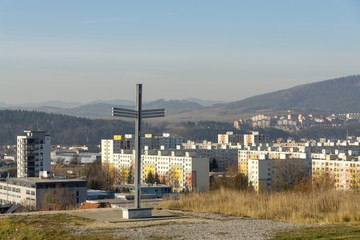 Iron cross statue on the meadow above the city. Zilina, Slovakia