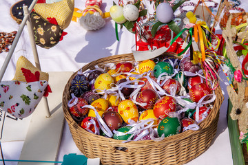 Decorative Easter eggs in basket and other toys for sale on market stall