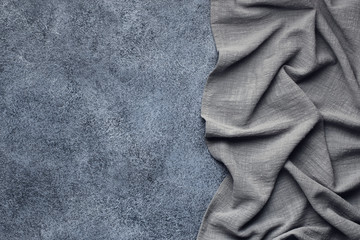 Gray tablecloth from right side concrete table top view. Food background