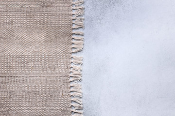 Gray handmade tablecloth from right side concrete table top view. Food background