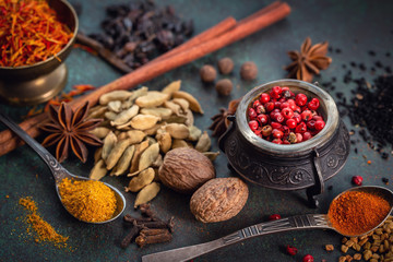 Various spices on dark table closeup shot