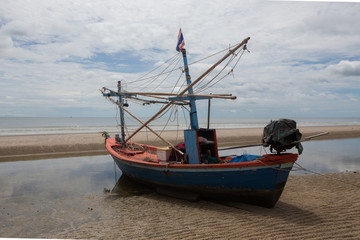 Fishing boat at the beach of Hua HI on a cloudy day, Thailand,