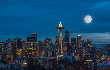 The lights come on in Seattle with a full moon Wall mural