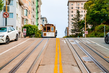 San Francisco, USA. July 18, 2018. Traditional classic cable car in San Francisco going up and down the hills. Wall mural