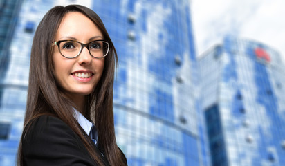 Business, young smiling businesswoman outdoor in a modern city setting