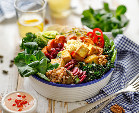 Buddha bowl of mixed vegetables,tofu cheese and groats. Healthy and nutritious vegan meal. Healthy eating concept