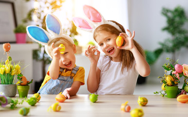 Happy easter! funny funny children   with ears hare getting ready for  holiday