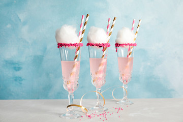 Cocktail with cotton candy in glasses on table