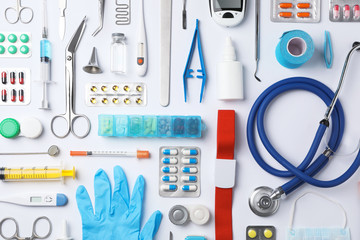 Flat lay composition with medical objects on white background