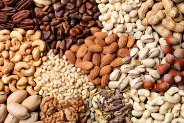 Organic mixed nuts as background, top view