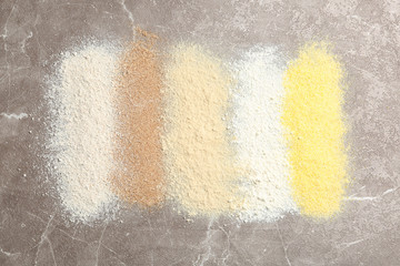 Stripes of different flour types on table, top view
