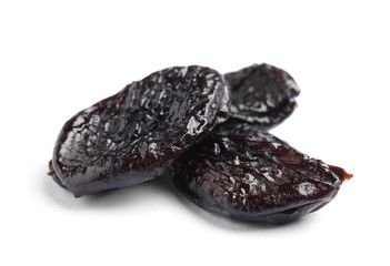 Tasty prunes on white background. Dried fruit as healthy snack