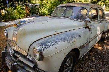 old abandoned car in shade