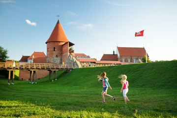 Two kids playing near Kaunas castle, situated in Kaunas, Lithuania