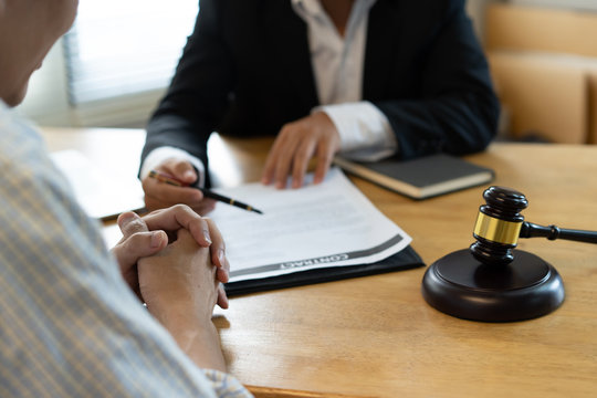 Lawyer consulting to client before sign business contract in the office.