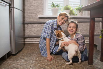 Mom and daughter play with the dog