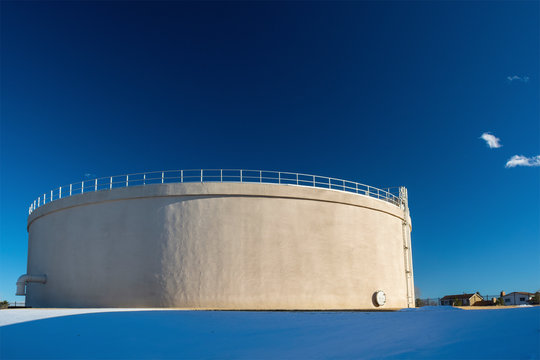 Giant Municipal City Water Tank on a Sunny, Clear Day with Snow