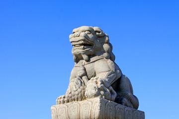stone lion on bridge railing, China