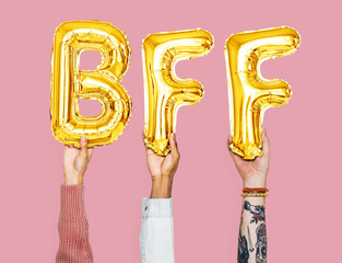 Hands holding BFF word in balloon letters