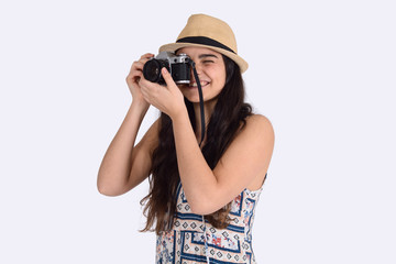 Young woman in summer hat with vintage camera.