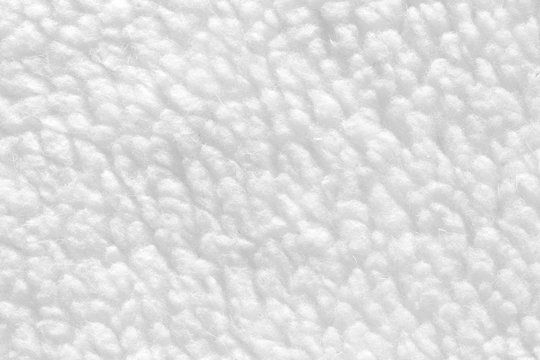 White sheep fur with a texture of fibers. Pattern soft canvas for various purposes.