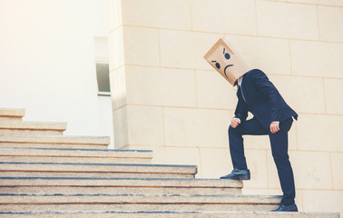 Businessman masked stress on the company stairs.